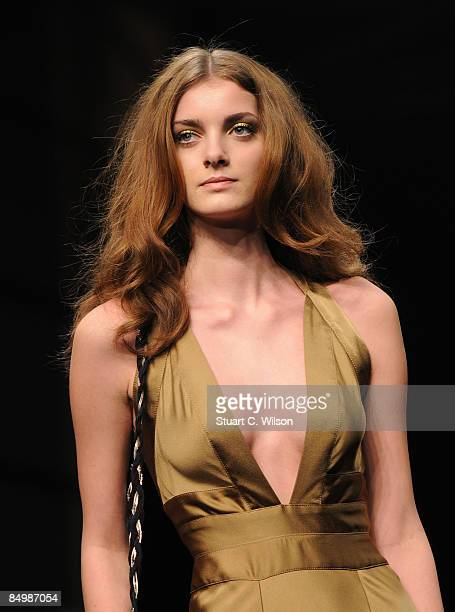 A model walks down the catwalk during the Ossie Clarke show as part of London Fashion Week a/w 2009 at the BFC Tent Natural History Museum on...