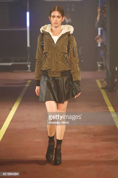A model walks down the catwalk during the Reserved Let's Fashion Party at the MercedesBenz Fashion Week Spring/Summer 2015 at Alte Muenze on July 10...