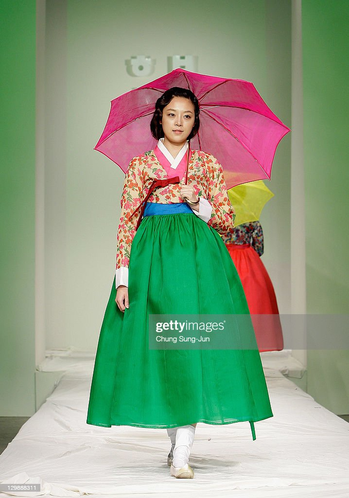 A Model walks down the catwalk during the South Korean Traditional Costume 'HanBok' fashion show on October 21, 2011 in Seoul, South Korea. Hanbok is the traditional Korean dress. It is often characterized by vibrant colors and simple lines without pockets. Although the term literally means 'Korean clothing', hanbok today often refers specifically to hanbok of Joseon Dynasty and is worn as semi-formal or formal wear during traditional festivals and celebrations.