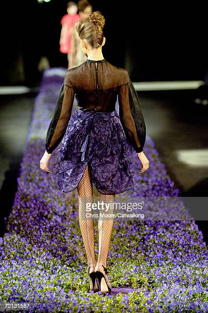 A model walks down the catwalk during the Yves Saint Laurent Fashion Show as part of Paris Fashion Week Spring/Summer 2007 on October 5 2006 in Paris...