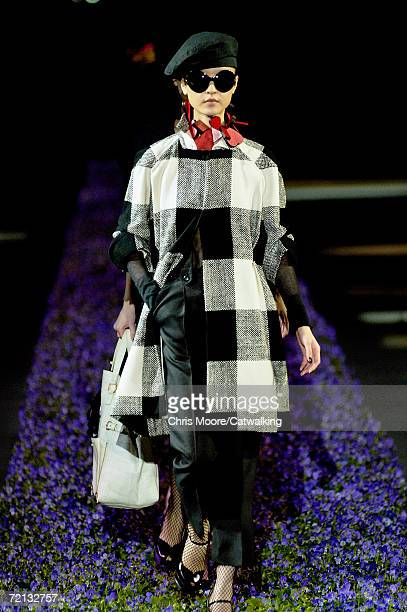 Model walks down the catwalk during the Yves Saint Laurent Fashion Show as part of Paris Fashion Week Spring/Summer 2007 on October 5, 2006 in Paris,...