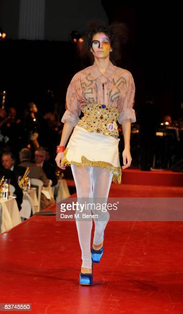 A model walks down the catwalk showcasing Vivienne Westwood's Gold Label Collection during the Chaos Point Gala Dinner in collaboration with the...