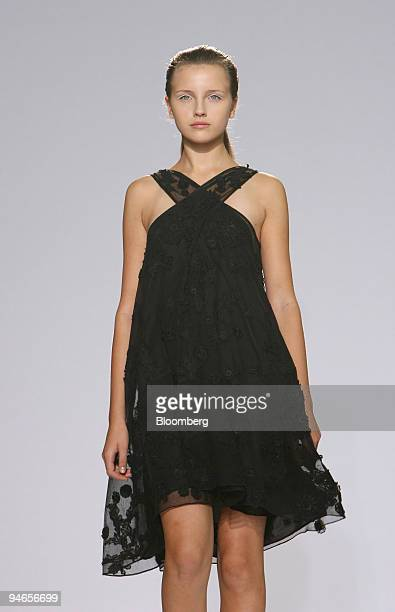 A model walks down the catwalk wearing a floral applique cross over dress during the showing of fashion designer Nicole Farhi's 2007 spring/summer...
