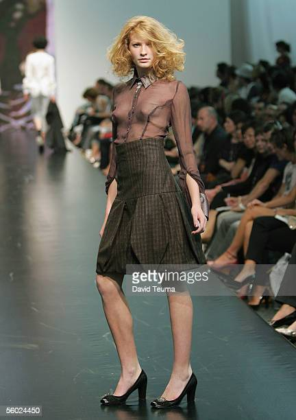 Model walks down the catwalk wearing a Onefell Swoop design during the New Generation show at Mercedes Australian Fashion Week at Federation Square...