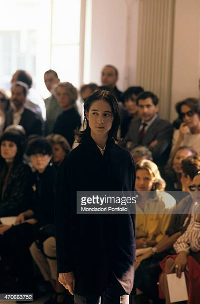 'A model walks down the catwalk wearing an essential cutted dress by Romeo Gigli Milan 1986 '