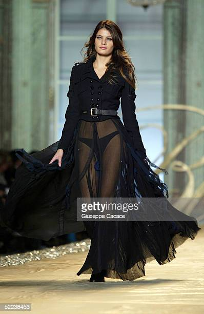 Model walks down the runway at Blumarine fashion show as part of Milan Fashion Week Autumn/Winter 2005/6 at Fiera di Milano on February 24, 2005 in...