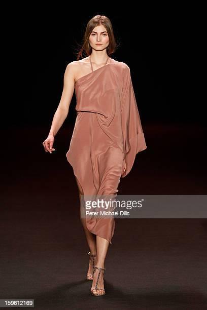 Model walks down the runway at Michael Sontag Autumn/Winter 2013/14 fashion show during Mercedes-Benz Fashion Week Berlin at Brandenburg Gate on...