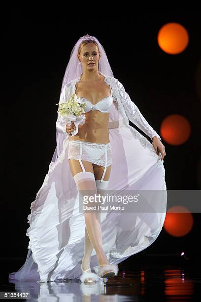 A model walks down the runway at the 22nd annual Macy's Passport 2004 Evolution Revolution at Fort Mason Center September 23 2004 in San Francisco...