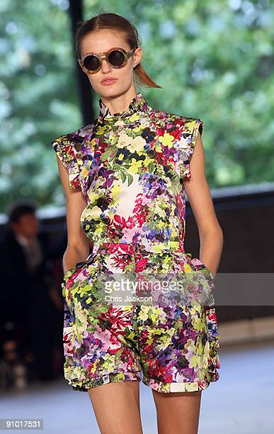 A model walks down the runway at the Erdem Spring/Summer 2010 show at the Queen Elizabeth II Hall during London Fashion Week on September 22 2009 in...