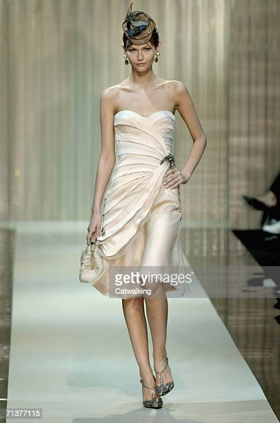 Model walks down the runway at the Giorgio Armani show as part of Paris Haute Couture Collections on July 5, 2006 in Paris, France.