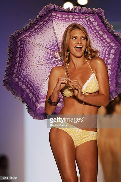 """Model walks down the runway at the Jessica Simpson swimwear fashion show during """"Mercedes Benz Fashion Week: Miami Swim"""" at the Raleigh Hotel on July..."""