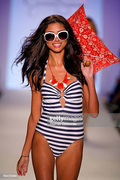 "Model walks down the runway at the Jessica Simpson swimwear fashion show during ""Mercedes Benz Fashion Week: Miami Swim"" at the Raleigh Hotel on July..."