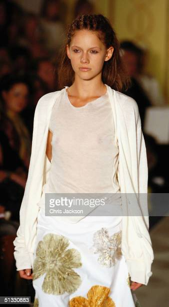 A model walks down the runway at the John Rocha fashion show as part of London Fashion Week Spring/Summer 2005 at Claridge's on September 20 2004 in...