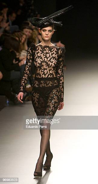 A model walks down the runway at the Juana Martint show during Cibeles Madrid Fashion Week Autumn/Winter 2010 on February 23 2010 in Madrid Spain