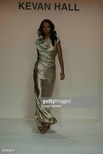 A model walks down the runway at the Kevan Hall Spring 2005 show at the MercedesBenz Fashion Week at Smashbox Studios in Culver City California