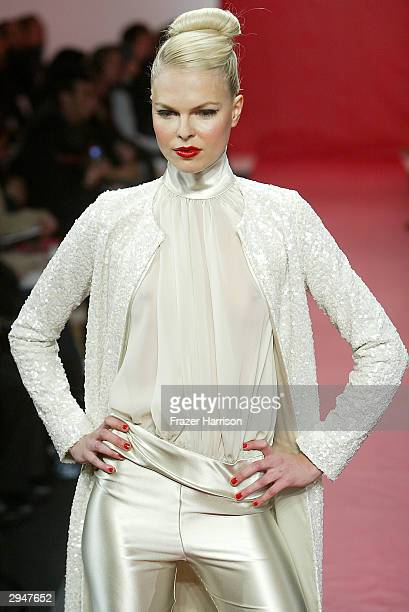 A model walks down the runway at the Marc Bouwer Fall 2004 Fashion show during Olympus Fashion Week at Atelier February 8 2004 in New York City