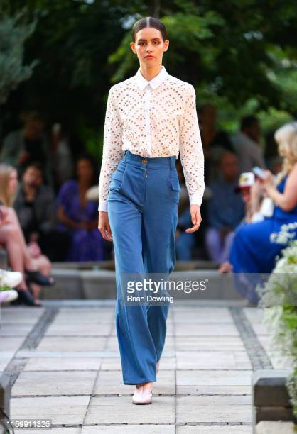 A model walks down the runway at the Marcel Ostertag Fashion Show during the Berlin Fashion Week Spring/Summer 2020 at Westin Grand Hotel on July 03...