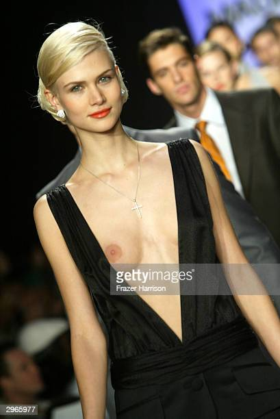 A model walks down the runway at the Maurice Malone Fall 2004 Fashion show on February 10 2004 during Olympus 2004 Fashion Week at Studio Noir in...