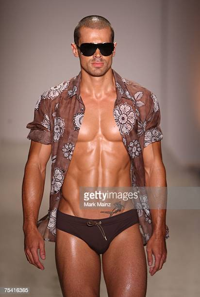 """Model walks down the runway at the Parke & Ronen swimwear fashion show during """"Mercedes Benz Fashion Week: Miami Swim"""" in the Oasis tent at the..."""