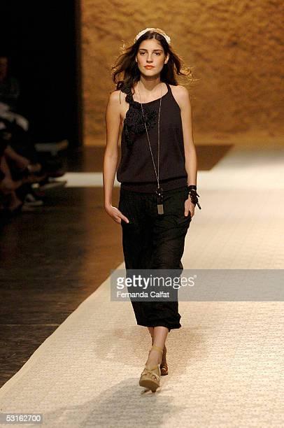 A model walks down the runway at the Patachou Por Tereza Santos Summer 2006 fashion presentation during Sao Paulo Fashion Week June 28 2005 in Sao...