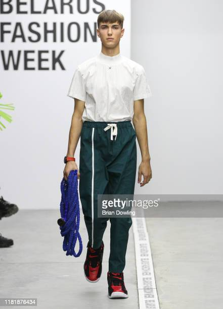 Model walks down the runway at the Scapegoat_404 by HUAWEI fashion show during the Belarus Fashion Week Spring/Summer 2020 on October 18, 2019 in...
