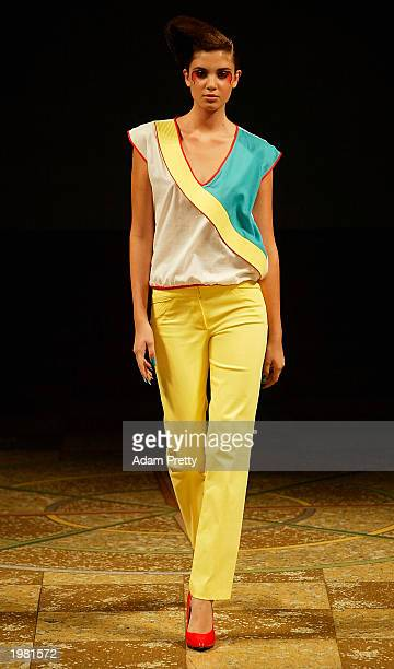 A model walks down the runway at the Tina Kalivas Spring/Summer 2003 Collection fashion show in the Cargo Hall at the Overseas Passenger Terminal May...