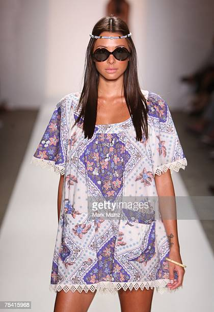 A model walks down the runway at the Zimmermann swimwear fashion show during 'Mercedes Benz Fashion Week Miami Swim' in the Beachway tent at the...