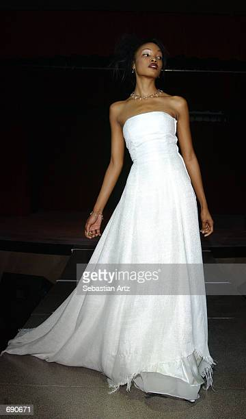 A model walks down the runway during a Fredericks fashion show at the opening of the Hollywood night club The Highlands January 8 2002 in Los Angeles...