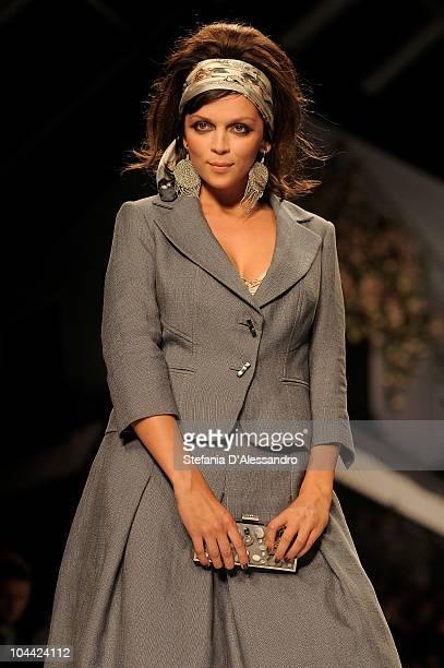 683c443d5d1b A model walks down the runway during Elena Miro Spring Summer 2011 fashion  show during