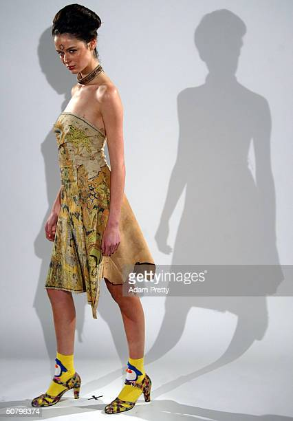 A model walks down the runway during the Akira Collection Show at Mercedes Australian Fashion Week Launch at Sydney University May 3 2004 in Sydney...