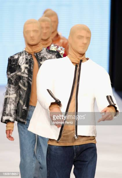A model walks down the runway during the Andreas Eklof S/S 2013 Fashion Show from the Swedish School of Textiles during the MercedesBenz Stockholm...