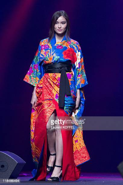 A model walks down the runway during the AOI clothing fashion show held during the Japan Expo Festival on July 3 2011 in Villepinte France
