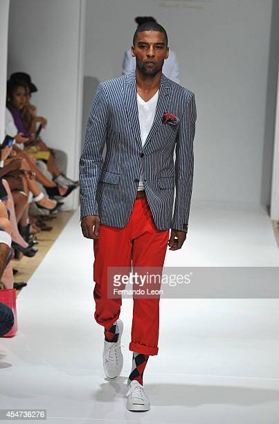 A model walks down the runway during the Argyleculture By Russell Simmons fashion show at Helen Mills Event Space on September 5 2014 in New York City