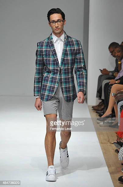 A model walks down the runway during the Argyleculture By Russell Simmons fashion show during MercedesBenz Fashion Week Spring 2015 at Helen Mills...