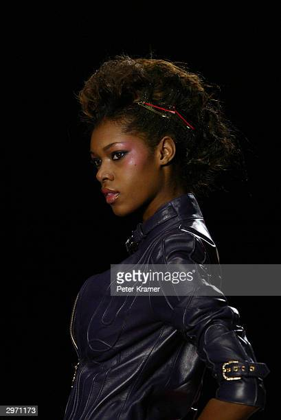 A model walks down the runway during the Baby Phat Fall 2004 Fashion show during Olympus Fashion Week at Gotham February 11 2004 in New York City