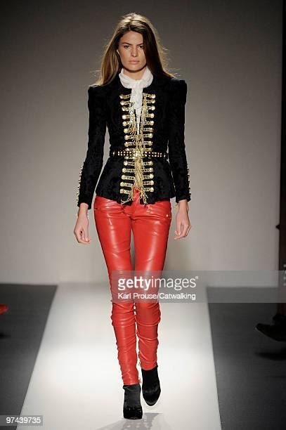 A model walks down the runway during the Balmain fashion show part of Paris Fashion Week Paris on March 4 2010 in Paris France