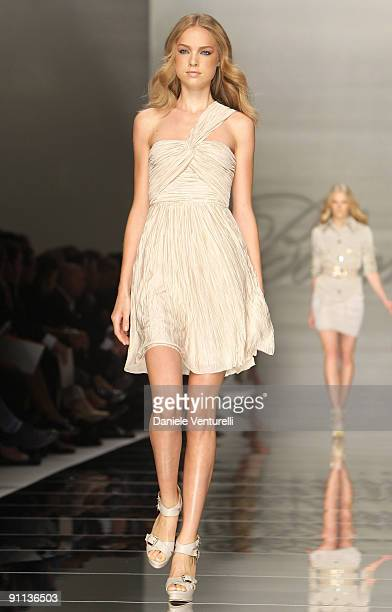 Model walks down the runway during the Blumarine Milan Womenswear Fashion Week Spring/Summer 2010 at the Milano Fashion Center at on September 25,...