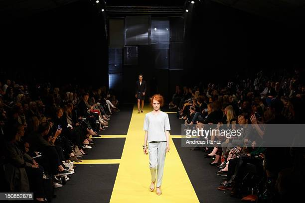 Model walks down the runway during the Carin Wester S/S 2013 Fashion Show at the Mercedes-Benz Stockholm Fashion Week on August 27, 2012 in...