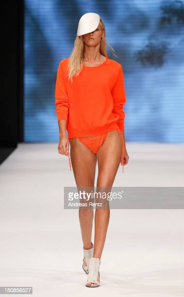 Model walks down the runway during the Dagmar S/S 2013 Fashion Show at the Mercedes-Benz Stockholm Fashion Week on August 28, 2012 in Stockholm,...