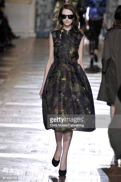 A model walks down the runway during the Dries Van Noten fashion show part of Paris Fashion Week on March 3 2010 in Paris France