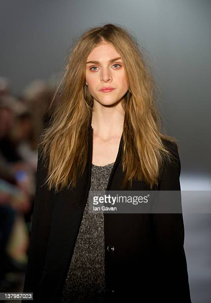A model walks down the runway during the Filippa K A/W 2012 fashion show at Moderna Museet on January 30 2012 in Stockholm Sweden