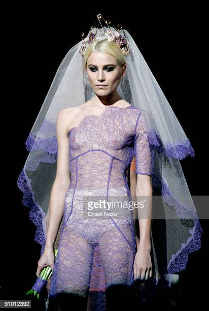 A model walks down the runway during the House of Holland show at LFW Spring Summer 2010 fashion show at The Guildhall on September 21 2009 in London...