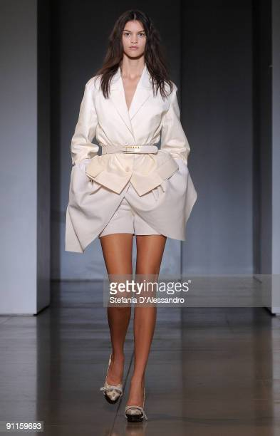 Model walks down the runway during the Jil Sander show as part of Milan Womenswear Fashion Week Spring/Summer 2010 on September 25, 2009 in Milan,...
