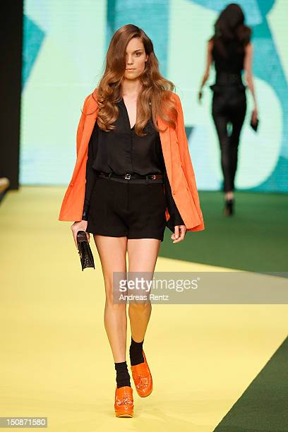A model walks down the runway during the JLindeberg S/S 2013 Fashion Show at the MercedesBenz Stockholm Fashion Week on August 28 2012 in Stockholm...