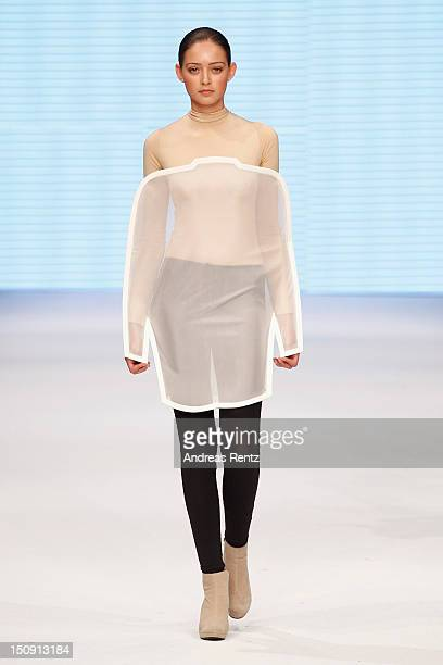 A model walks down the runway during the Johan Nordberg S/S 2013 Fashion Show from the Swedish School of Textiles during the MercedesBenz Stockholm...