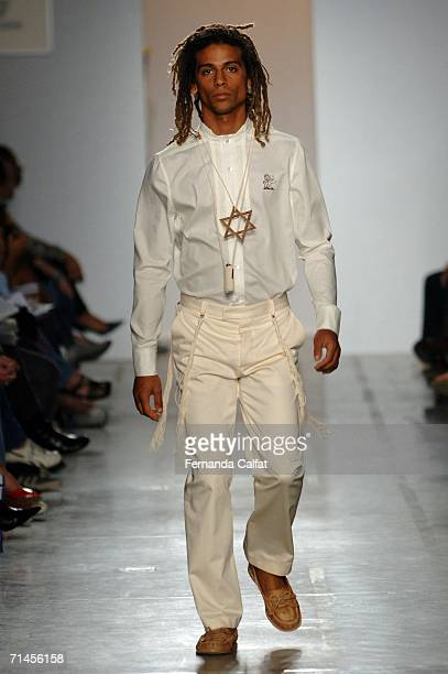 A model walks down the runway during the Man By Alexandre Herchcovitch Summer 2007 fashion show at Bienal Ibirapuera on July 15 2006 in Sao Paulo...