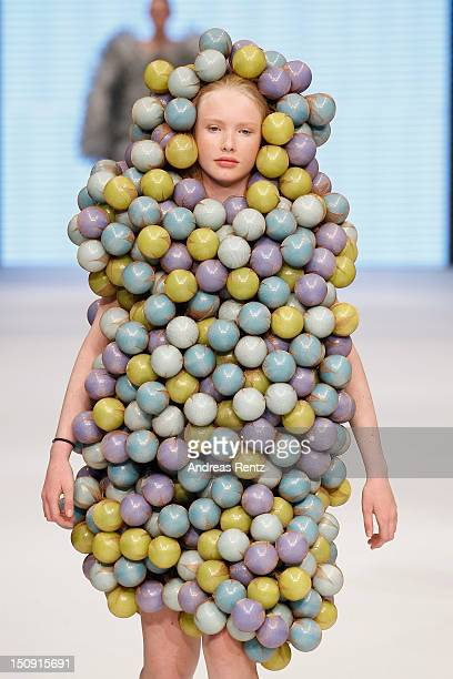 Model walks down the runway during the Maria Sofia Bahlner S/S 2013 Fashion Show from the Swedish School of Textiles during the Mercedes-Benz...