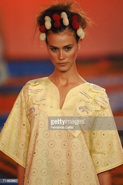 A model walks down the runway during the Ronaldo Fraga Summer 2007 fashion show at Bienal Ibirapuera on July 16 2006 in Sao Paulo Brazil