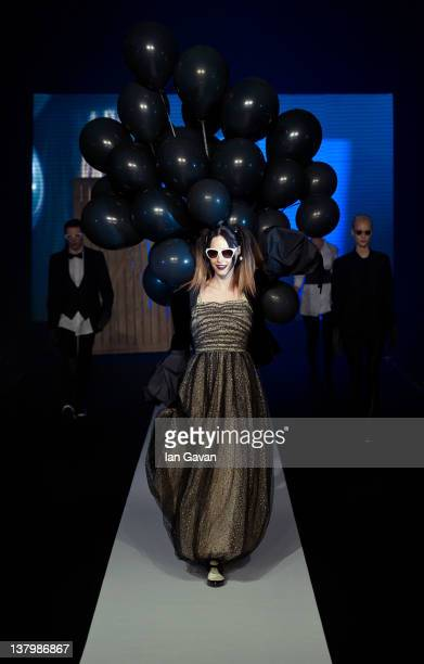 A model walks down the runway during the Safilo fashion show at the MercedesBenz Fashion Pavilion on January 30 2012 in Stockholm Sweden