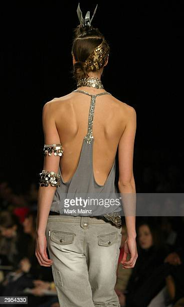 Model walks down the runway during the Sass & Bide Fall 2004 fashion show at Bryant Park during the Olympus 2004 Fashion Week February 7, 2004 in New...